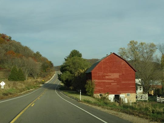 At Genoa, turn onto Highway 56 east, which takes you through town and over the hills, along the coulees, and through the stair-step terraced farm fields of the Driftless Area.