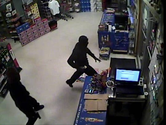 In this still taken from security camera footage, two