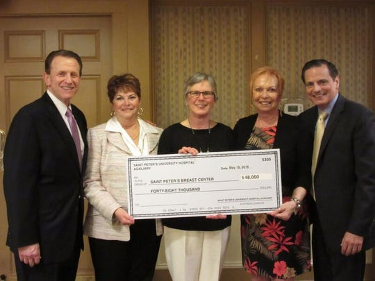 Susan McManus, MD, center, director of The Breast Center at Saint Peter's University Hospital, accepts a donation of $48,000 from the Saint Peter's University Hospital Auxiliary. The funds were raised at the auxiliary's annual Spring Fashion Show. Joining McManus are, from left, Les Hirsch, president, Saint Peter's Healthcare System; Kathleen Killion, auxiliary president; Linda Massa, fashion show chairwoman; and Jim Choma, vice president, Saint Peter's Foundation. Killion and Massa are residents of North Brunswick. The funds were raised in support of the center's services, including screening and diagnostic testing, chemotherapy, radiation, surgery and post-treatment care. The Saint Peter's University Hospital Auxiliary has been in existence since 1908 and continues to support the hospital, donating approximately $2,093,000 to Saint Peter's between 1985 and 2016.