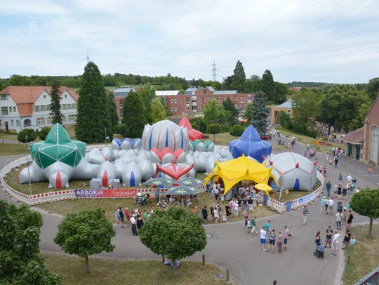 """The """"Arboria Luminarium"""" inflatable sculpture is half"""