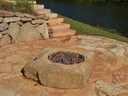 An outdoor fire pit designed by Alabama Landscape Creations.