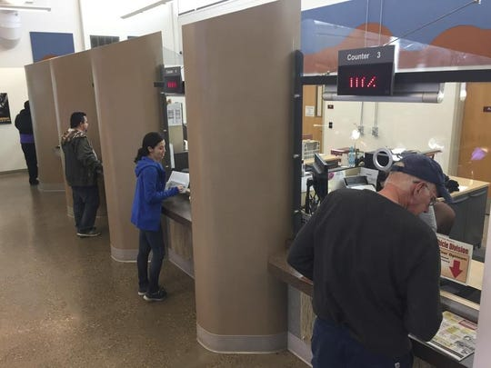 """Teresita Gonzales, center, attempts to renew her driver's license at Motor Vehicle Division offices in Santa Fe on Monday, Nov. 14, 2016. A U.S. citizen whose family has lived in New Mexico for generations, Gonzales expressed frustration with obtaining information about the new application requirements and said special driving authorization cards geared toward immigrants are """"conducive to racism."""" The state's driving IDs are getting an overhaul to comply with tougher federal identification requirements and so the state can continue granting driving privileges to people who are in the country illegally."""