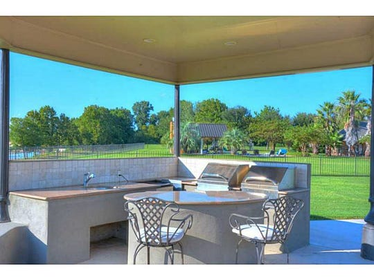 The outdoor kitchen at 33 River Breeze Road.