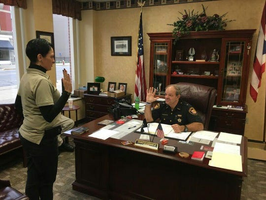Brandy Morris-Hafner is sworn in as the administrator of the Ross County day reporting program by Ross County Sheriff George Lavender.