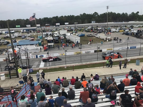 The green flag falls for the start of Sunday's race for the Outlaw Stock cars in the featured event on the season-opener for racing at Five Flags Speedway,