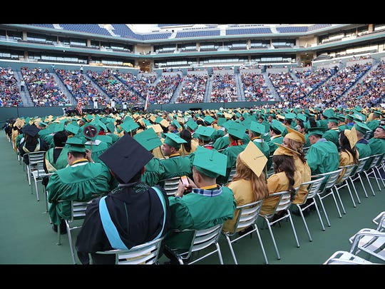 The 2014 class at Coachella Valley High School holds their graduation ceremony in the Indian Wells Tennis Garden Tuesday, June 10, 2014.