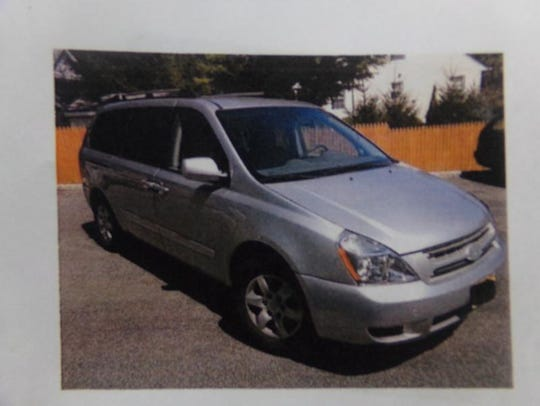 Police are searching for this silver Kia minivan bearing
