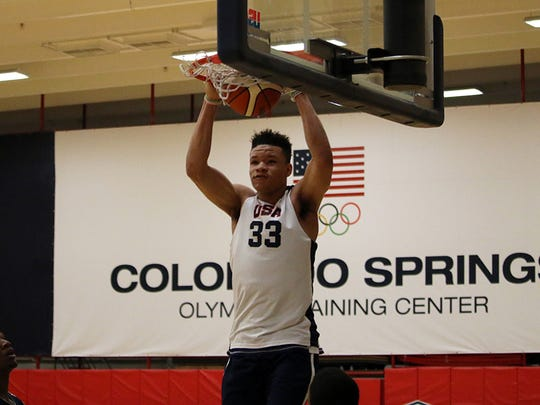 Kevin Knox dunks during Team USA training camp practice on Monday, June 19, 2017.