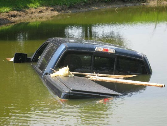 A woman crashed crashed into a pond off of Marlette
