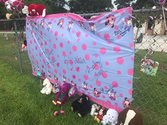 A makeshift memorial for a 3-year-old who died at In His Arms Christian Academy is pictured at the Pensacola day care on Tuesday, Aug. 22, 2017.