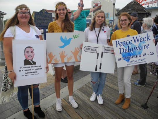 Young marchers gather on the Rehoboth Boardwalk for