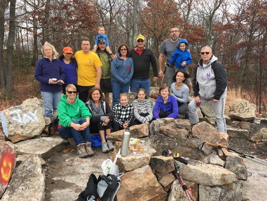 Hikers at the stone living room in Norvin Green State