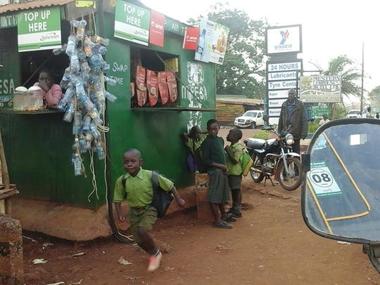 Parents accompany children to school in Busia town