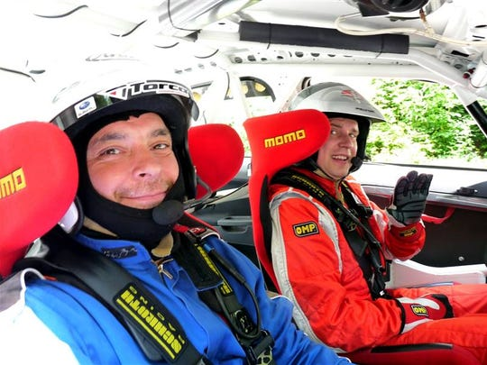 Marcel Ciascai, left, and Robert Martai get ready to compete in a rally race.