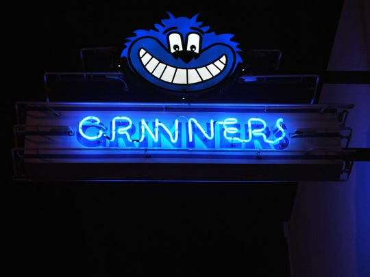 The neon sign outside Grinners Daiquiri Bar in downtown