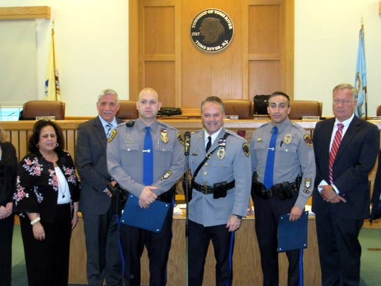 Toms River police Officers Joshua Kuhlwein (l) and