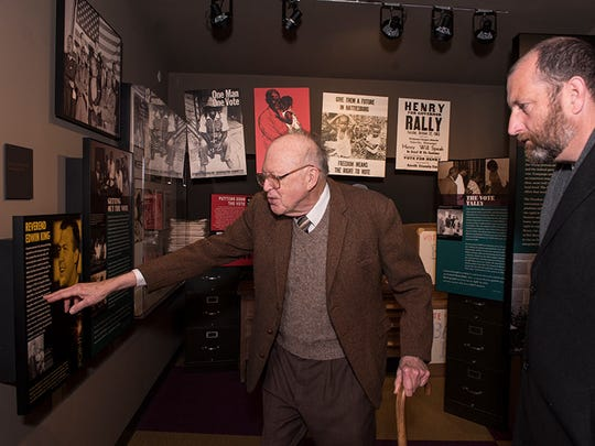 Touring the Mississippi Civil Rights Museum with Chris Goodwin, right, director of public information for the Department of Archives and History, the Rev. Ed King points to his former wife's name in an exhibit describing his work in the movement.