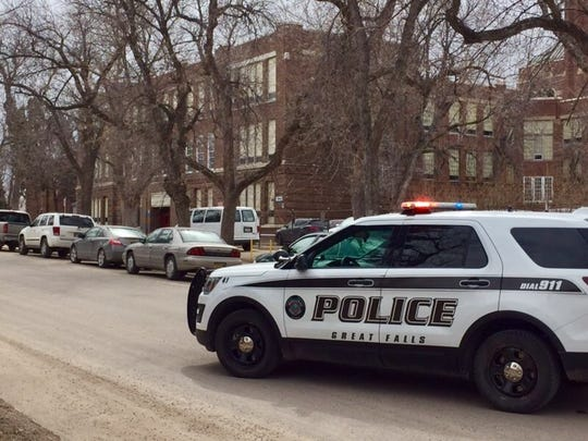 Police surround Great Falls High School.