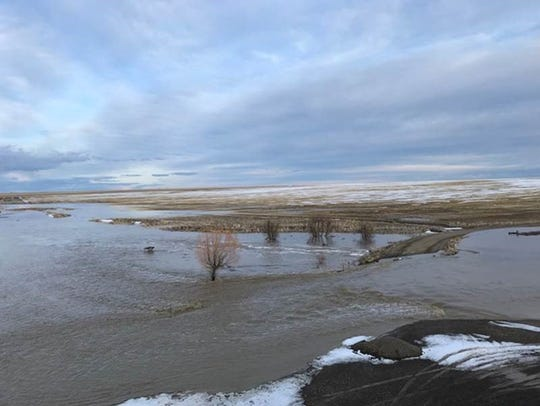Snow runoff caused flooding and washed out a road at
