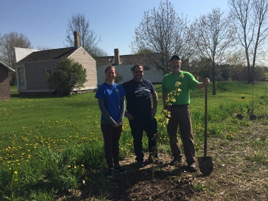 Manitowoc Noon Rotary has announced support of Manitowoc County Historical Society's Pinecrest Village landscape, purchasing and helping to plant more than 100 trees on the museum's grounds. Pictured, from left: Amy Meyer, Manitowoc County Historical Society executive director; Kyle Bryntesen, Manitowoc Noon Rotary Club; and Tony Dick, Manitowoc Noon Rotary Club and project leader.