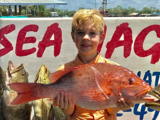 Young Mason Stone of Valdosta with a fine red snapper he caught last week while fishing with Capt. Frazier out of Steinhatchee.
