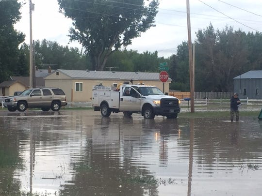 Floodwaters in Sun River reached Highway 200 by Tuesday evening.