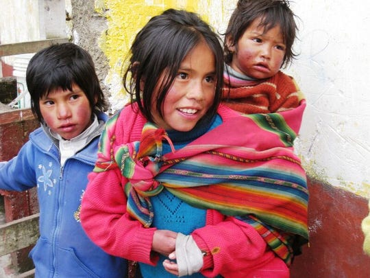 Some of the children in a Q'ero village stop to visit