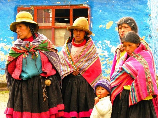Q'ero villagers often wear brightly colored clothes,