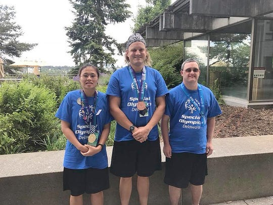 The Team Delaware swim team found success at the Special Olympics USA Games in Seattle last week (July 1-6), bringing home five gold medals, seven silver and two bronze. Pictured are Ginny Shaud (Rehoboth Beach), Scott Rohrbach (Wilmington) and Tyler Kennedy (Wilmington). Not pictured are Torie Moore (Newark) and Eric DiSabatino (Bear).