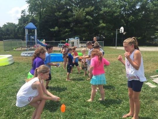Children in the Ellison School's Ellison Explorers summer program enjoy fun, learning activities.