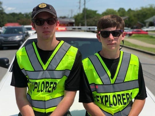 Mt. Juliet Police Department Explorers Michael Long and Jackson Kirkpatrick helping at a Splash Day event July 28, 2018, at Charlie Daniels Park.