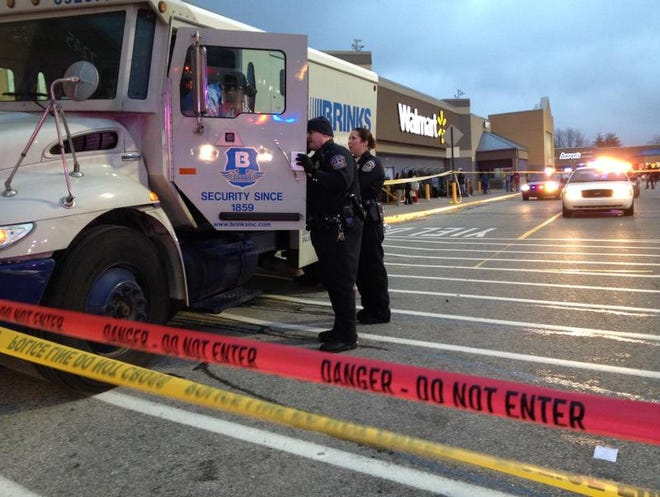 A man who tried to rob an armored car driver outside a Walmart on the Far Southside was shot and wounded by the guard's partner on Dec. 22, 2013. The shooting happened at 7245 S. U.S. 31 at about 4:30 p.m., according to Indianapolis Metropolitan police.