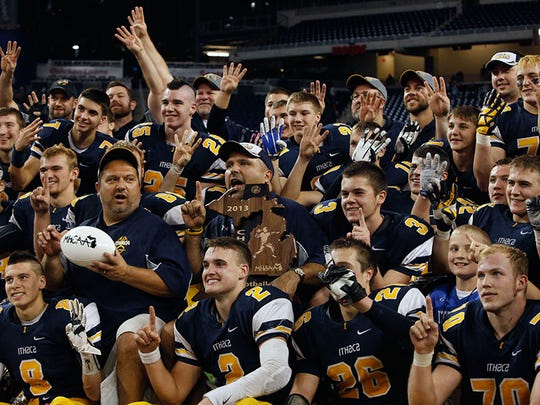 Ithaca is trying to take this picture at Ford Field