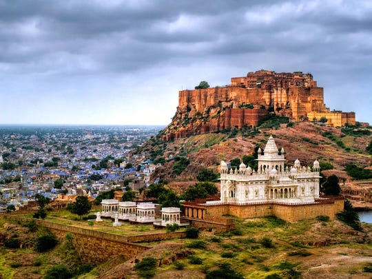 Mehrangarh Fort (building started in 1459) overlooking Jodhpur, the Blue City with Jaswant Thadi Mausoleum in the foreground.