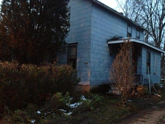 Police investigate dead body found at 'drug house'