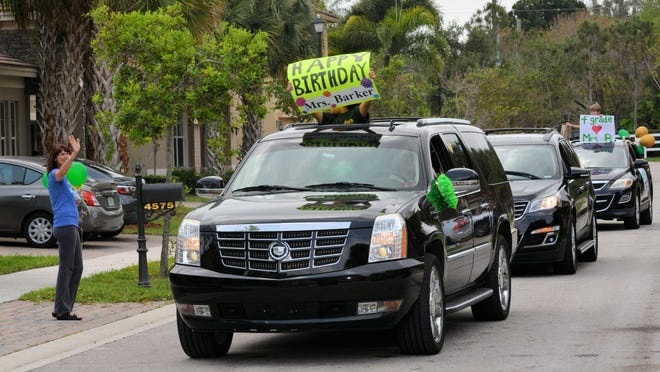 Boca Raton Christian School 4th grade teacher Tawnda Barker waves to her students who surprised her with a birthday parade on Friday, April 17, 2020 as students and teachers alike across Florida have moved to virtual classes in the wake of the coronavirus.