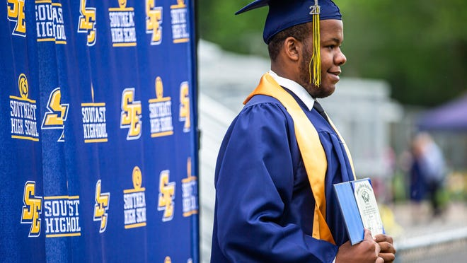Addonis Brown receives his diploma during in-person graduation at Southeast High School, Monday, June 1, 2020, in Springfield, Ill. District 186 is holding in-person graduation ceremonies at Southeast, Lanphier and Springfield High School this week to allow the Class of 2020 the opportunity to walk across the stage individually in their cap and gown and receive their diploma during the COVID-19 pandemic.