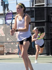 Wylie's Hailey Parker returns a serve behind girls doubles partner Madison Andrews during the Region I-4A tournament in Lubbock on Wednesday, April 18, 2018. Parker and Andrews reached the semifinals on Wednesday night..