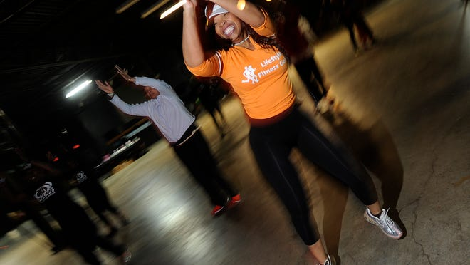 Felisia Newby of St. Clair Shores dances a workout routine during a fundraiser for the Burrell family in Detroit. The Detroit Fitness Community hosted a fitness fundraising event to help the Burrell family after a fire that killed their two sons, Quartez and Cortez in Detroit, at Bert's Warehouse on Sunday, Feb. 16, 2015.