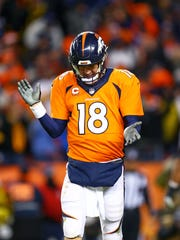 Denver Broncos quarterback Peyton Manning reacts after converting a two-point conversion in the divisional playoffs.