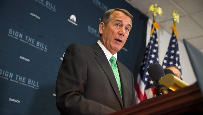 FILE - In this Oct. 21, 2015 file photo, House Speaker John Boehner of Ohio speaks during a news conference on Capitol Hill in Washington. Lawmakers are pushing to finalize a sweeping deal to fund the federal government before Boehner leaves Congress at the end of this week.  (AP Photo/Evan Vucci, File)