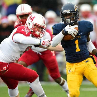 Kent State University freshman Antwan Dixon eludes a Miami of Ohio defender on Saturday during the Golden Flashes 20-14 win.