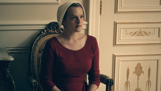 Elisabeth Moss stars as a woman whose rights are stripped away in Hulu's drama 'The Handmaid's Tale.'