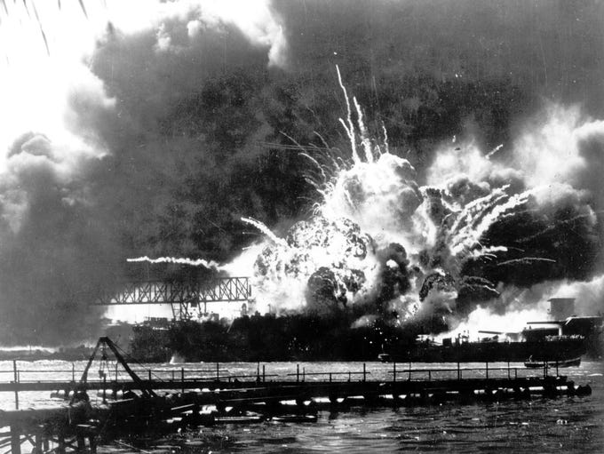The destroyer USS Shaw explodes after being hit by
