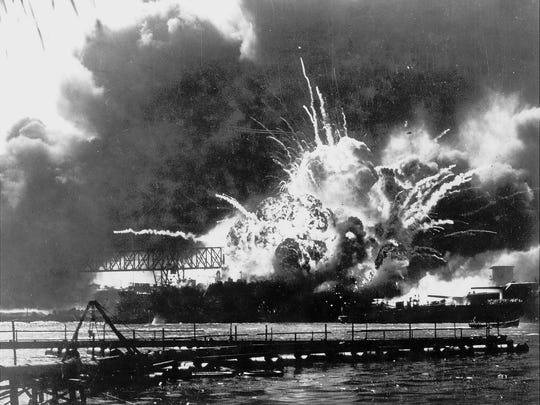The destroyer USS Shaw explodes after being hit by bombs during the Japanese surprise attack on Pearl Harbor, Hawaii. on Dec. 7, 1941.