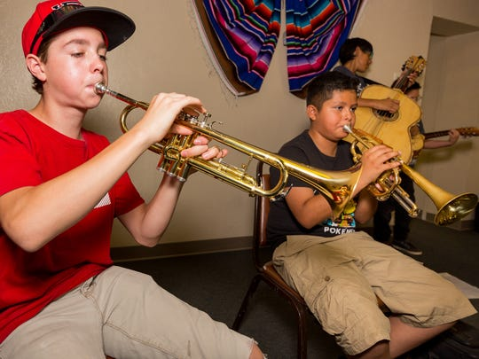 Richard Soular, 14, left, and Danny Flores, 11, right,