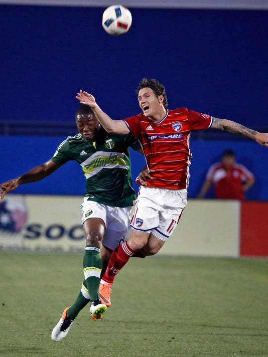 FC Dallas Zach Loyd (17) heads the ball over Portland Timbers Fanendo Adi (9) during the the first half of a MLS soccer game, Wednesday, May 11, 2016 in Frisco, Texas. (Nathan Hunsinger/The Dallas Morning News via AP) MANDATORY CREDIT; MAGS OUT; TV OUT; INTERNET USE BY AP MEMBERS ONLY; NO SALES