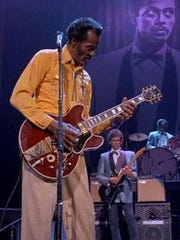 "Chuck Berry, with Keith Richards in the background, in a scene from the Taylor Hackford 1987 documentary, ""Chuck Berry: Hail! Hail! Rock 'N' Roll."""