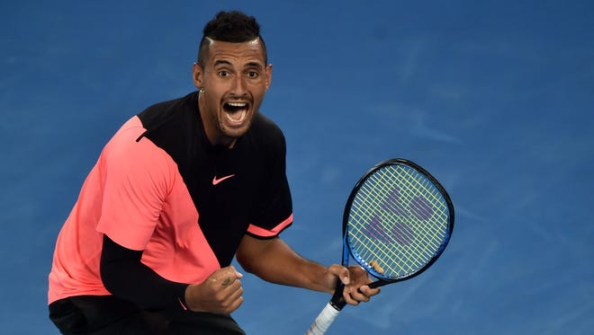 Australia's Nick Kyrgios celebrates after victory over France's Jo-Wilfried Tsonga during their men's singles third-round match on day five of the Australian Open tennis tournament in Melbourne on Jan. 19.