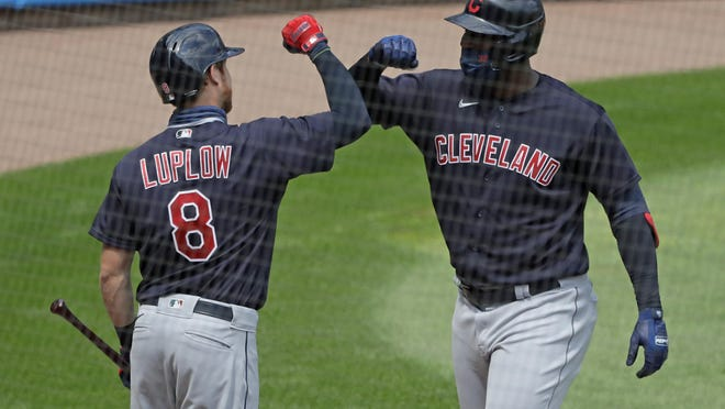 The Indians' Franmil Reyes, right, celebrates with Jordan Luplow after hitting a two-run home run during the fourth inning Saturday.